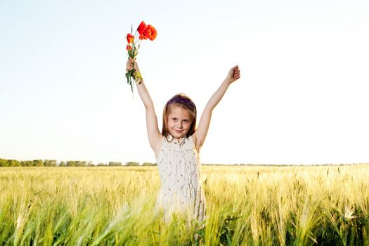 An image of a nice little girl in the field