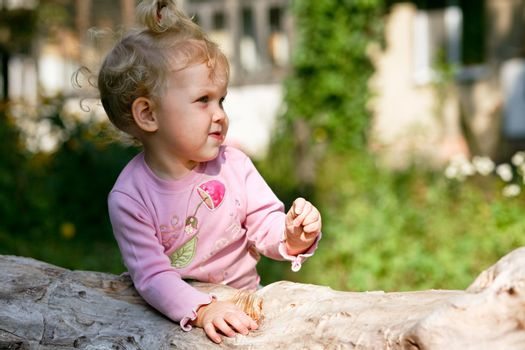 An image of little baby-girl playing outdoor