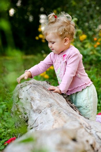 An image of little girl playing outdoor