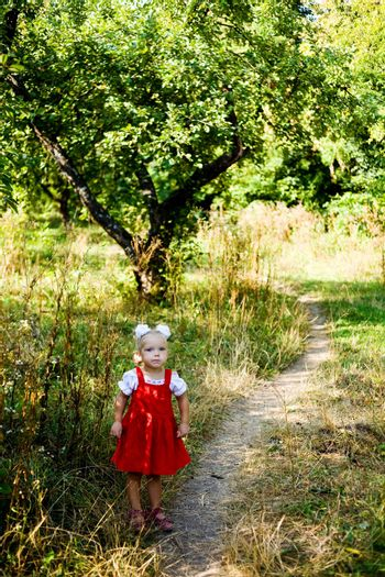 An image of a little girl standing on the lane