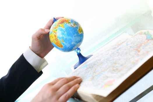 look on globe where to travel