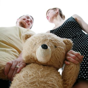 An image of a man and a woman with a teddy-bear
