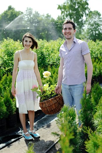 An image of a young couple with basket with roses