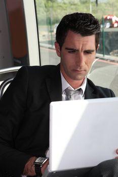 portrait of a man in public transportation