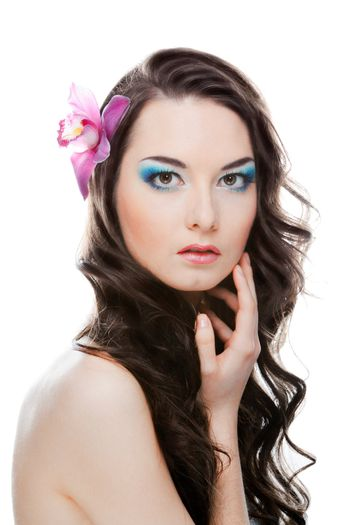 The beauty portrairt of woman with flower on head.