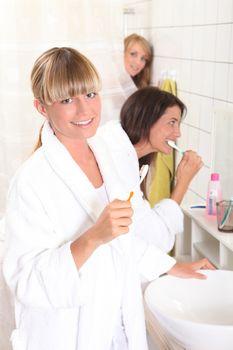 Young women brushing their teeth