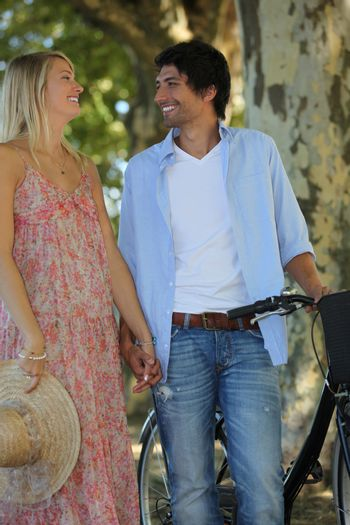 Romantic couple with a bike