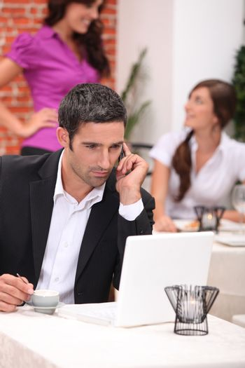 Businessman in a restaurant with a laptop