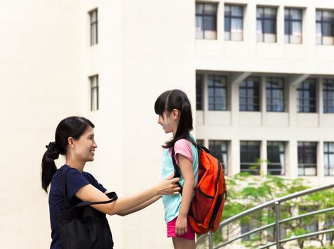 Mother and girl communication in the school