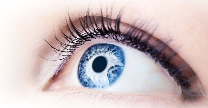 Beautiful abstract blue eye, extreme closeup