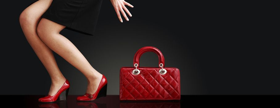 fashionable woman with a red bag, fashion photo