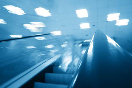 escalator transportation motion blured business background