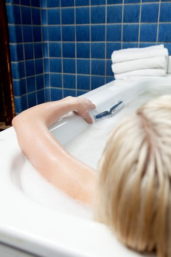 An abstract detail of a woman in a spa bath, shallow depth of field - focus on hand