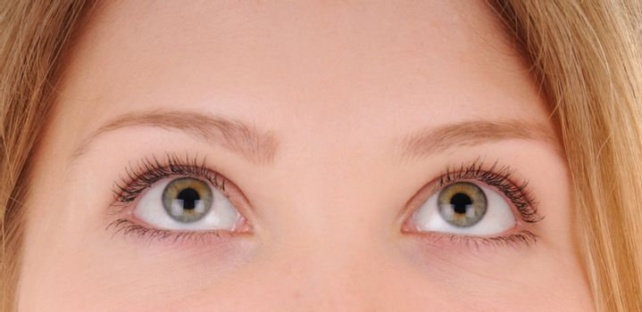 Beauty woman eyes are looking up