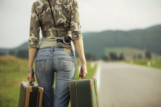 Young woman runaway walks away road. Copy space