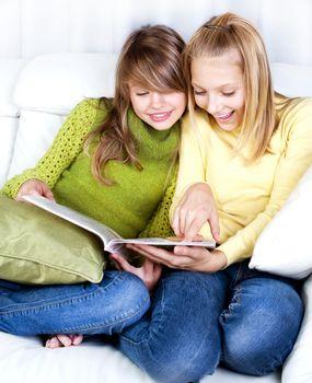 Teenage Girls reading fashion Magazine