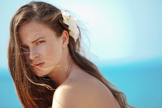 Portrait of very beautiful young girl posing at the summer beach