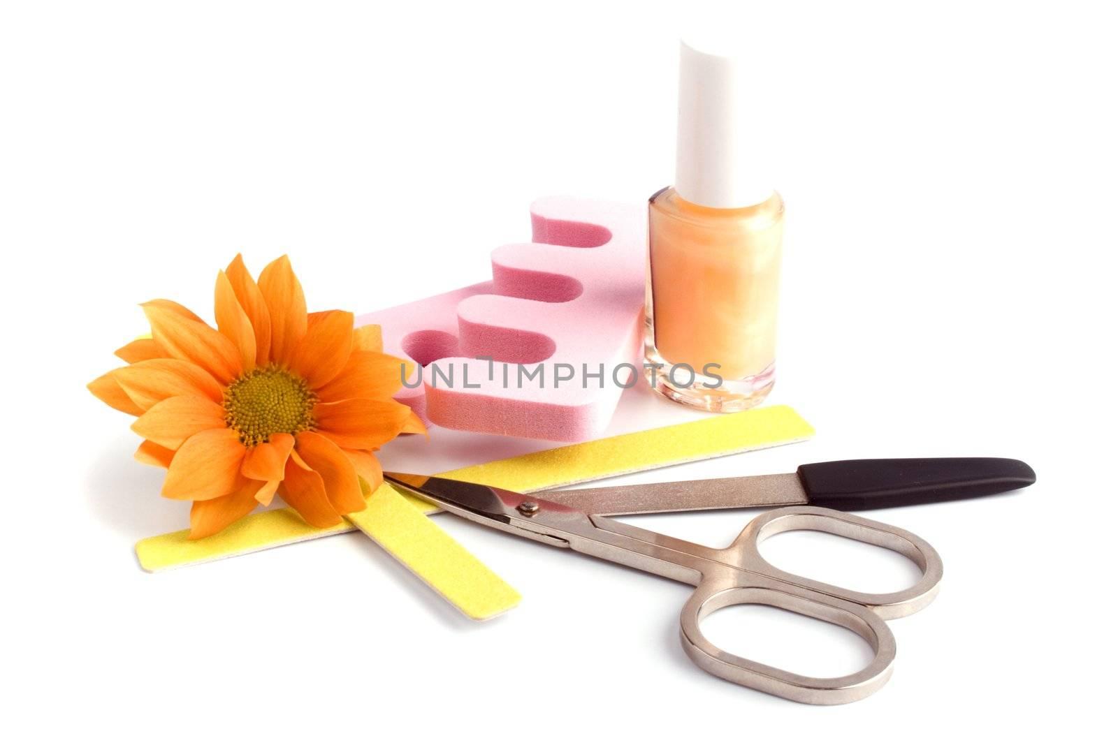 pedicure beauty set and flower closeup