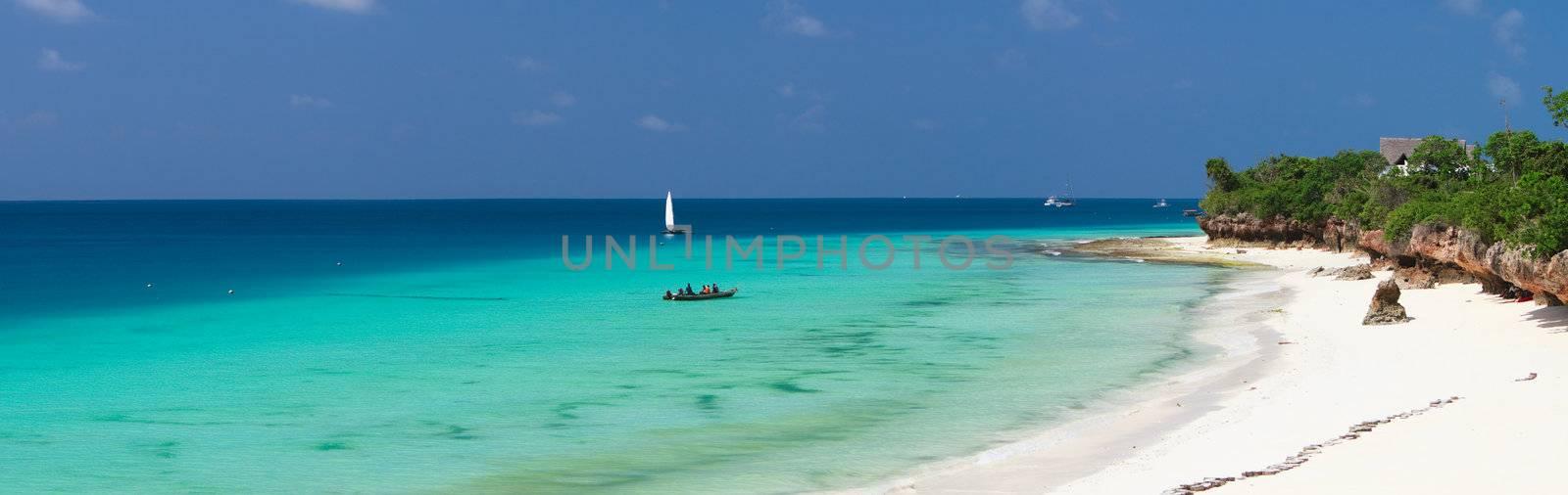 Beautiful landscape of white sand tropical beach on north-west coast of Zanzibar island