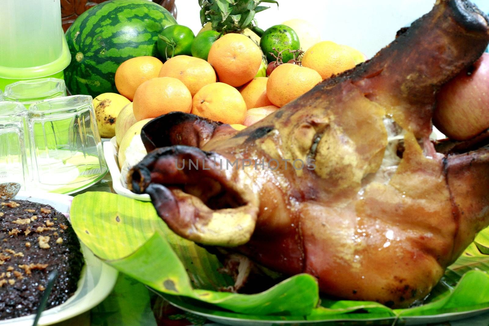 Lechon - a filipino delicacy during festivities and holiday seasons with fruits and rice cakes.