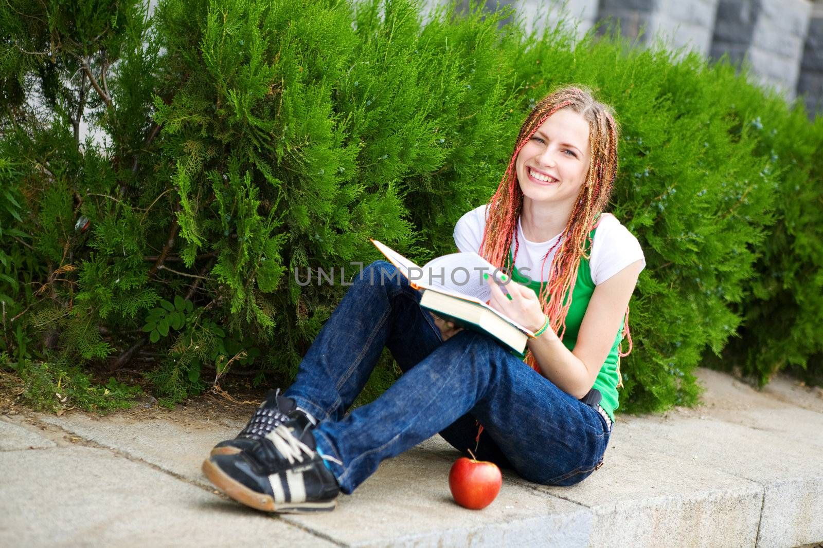 girl with a book near the school