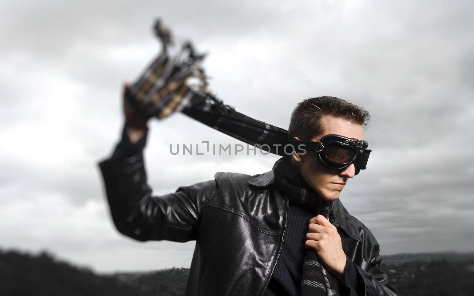 Male model poses as a pilot, selective focus