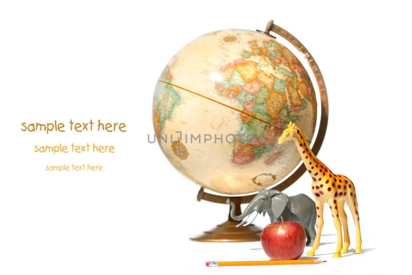 World globe with toy animals and apple on white background