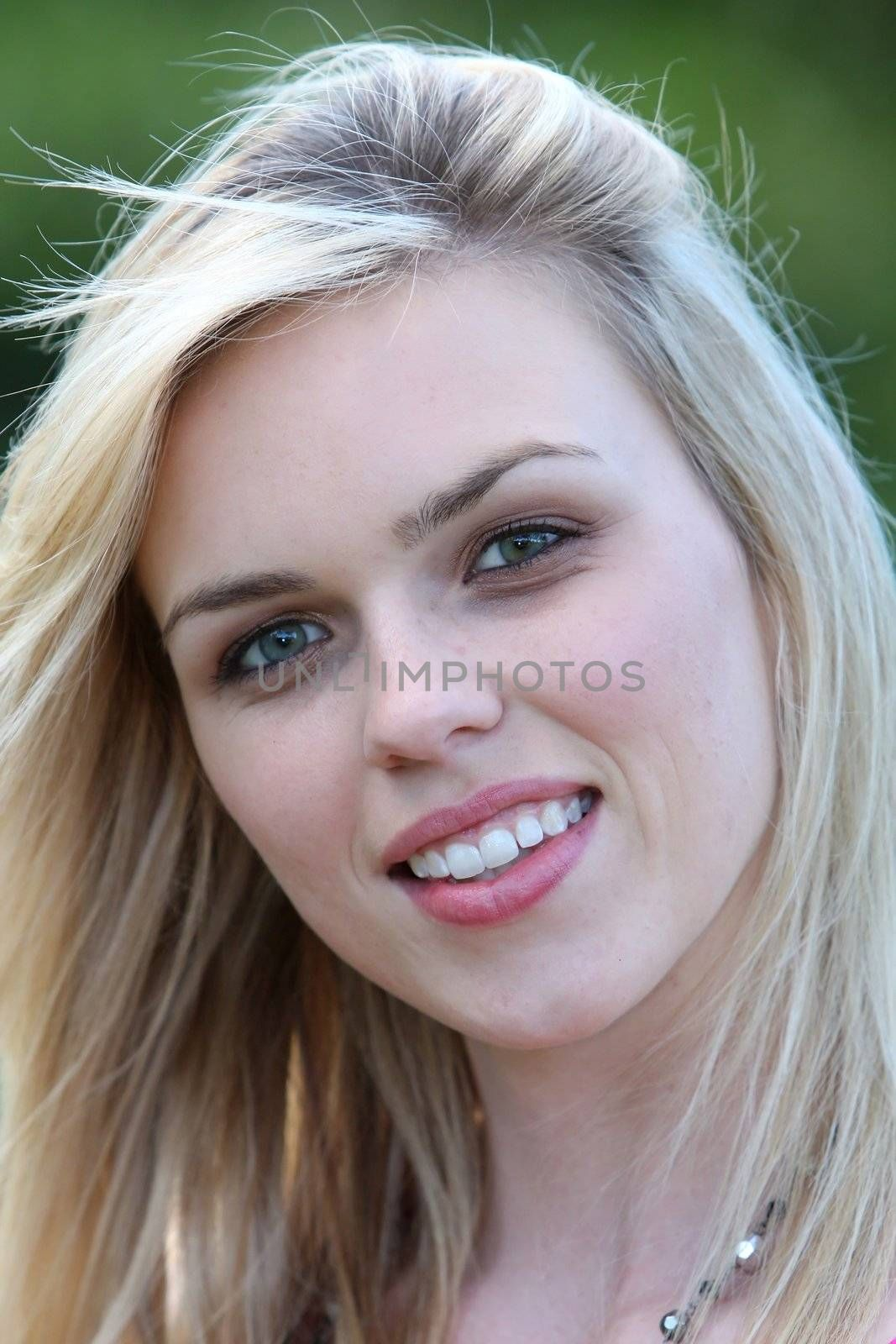 Gorgeous blond smiling woman with beautiful eyes