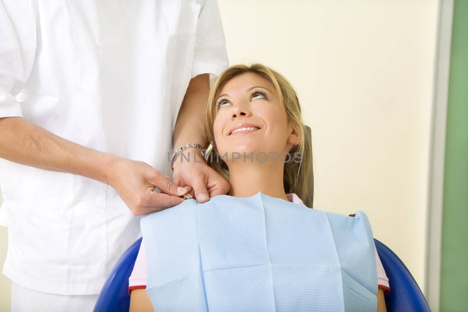 dentist and his patient in examination room. Copy space