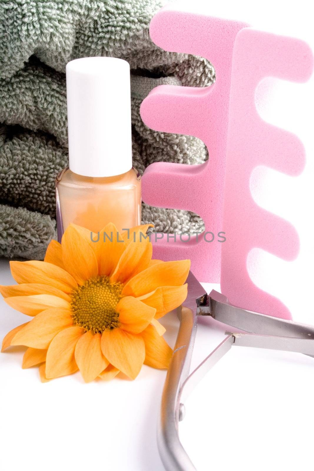 pedicure beauty set, flower and towel on white background