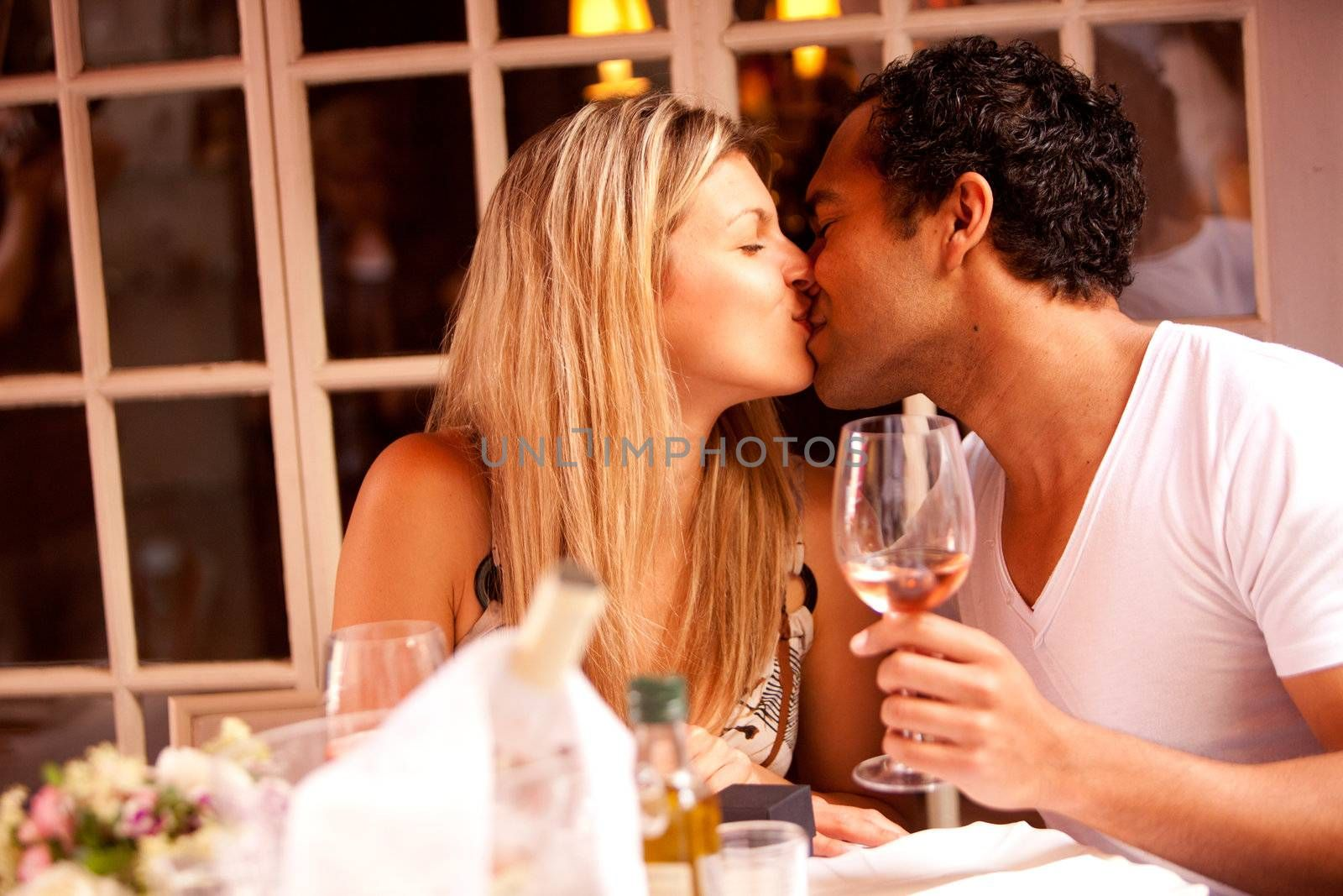 A man and woman having a romantic meal in an outdoor cafe