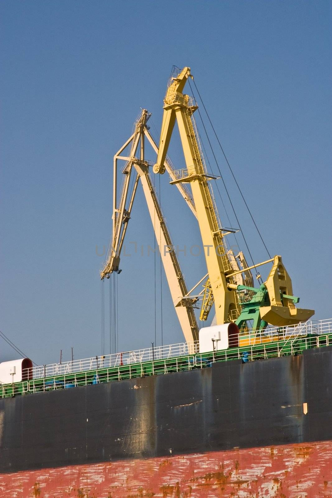 transportation series:  crane of dry cargo ship in the port