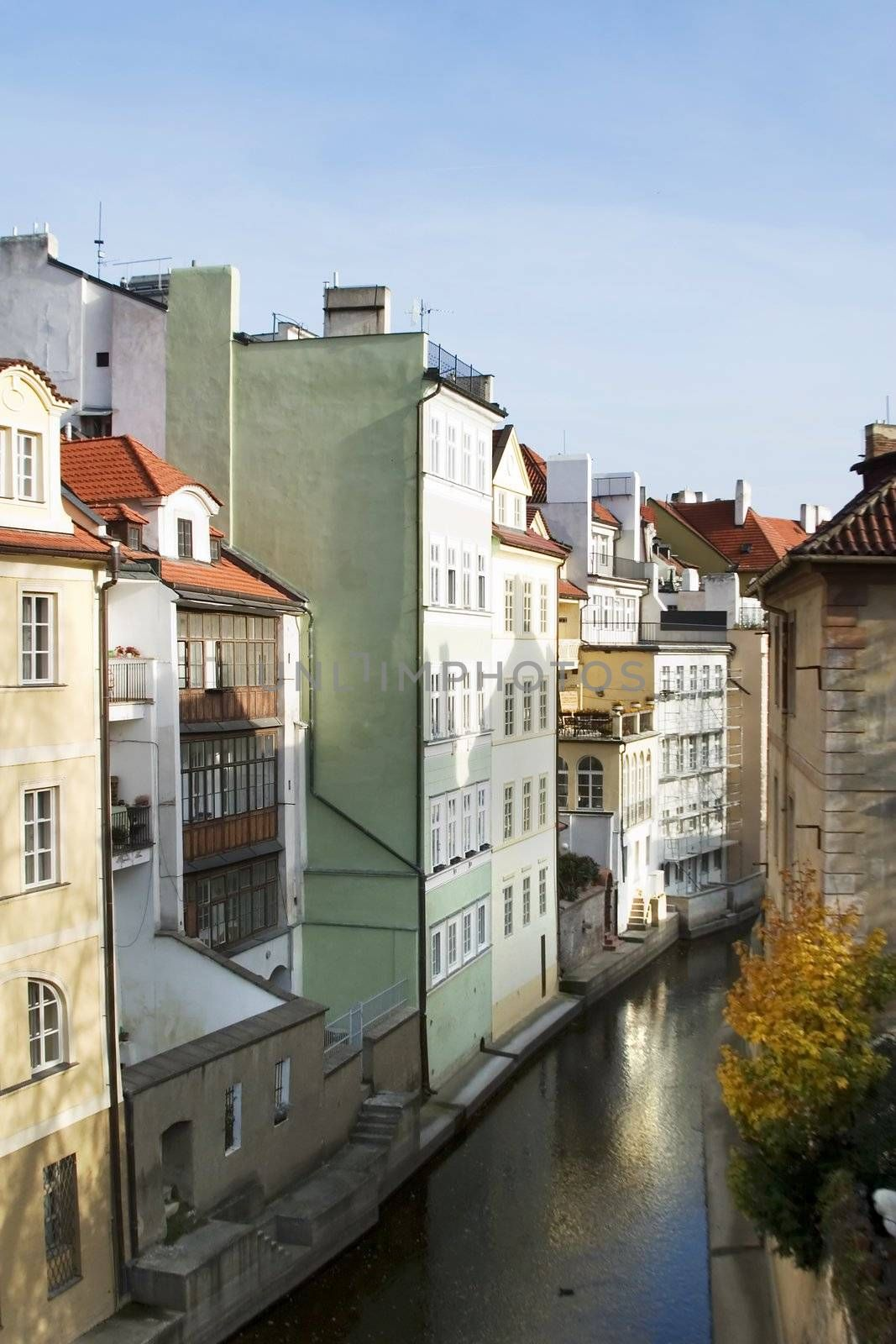 Abstract building detail in Prague, Czech Republic.  This small flow of water looks a lot like venice.