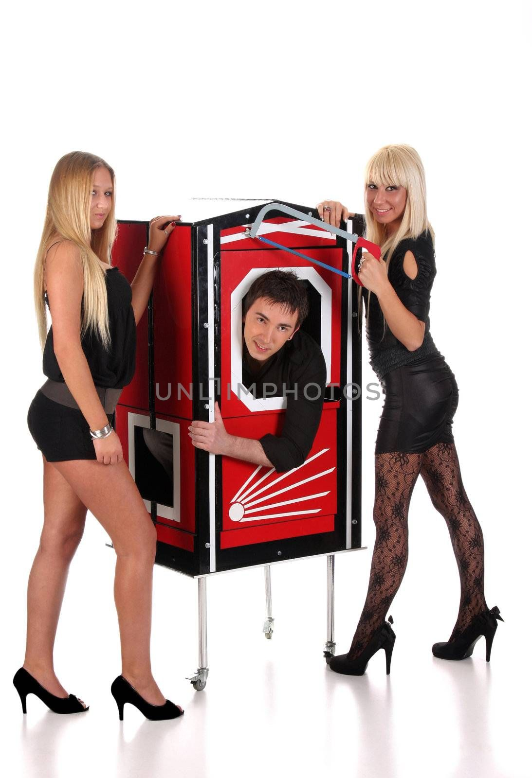 Magician performance and two beauty girls in a magic box with handsaw