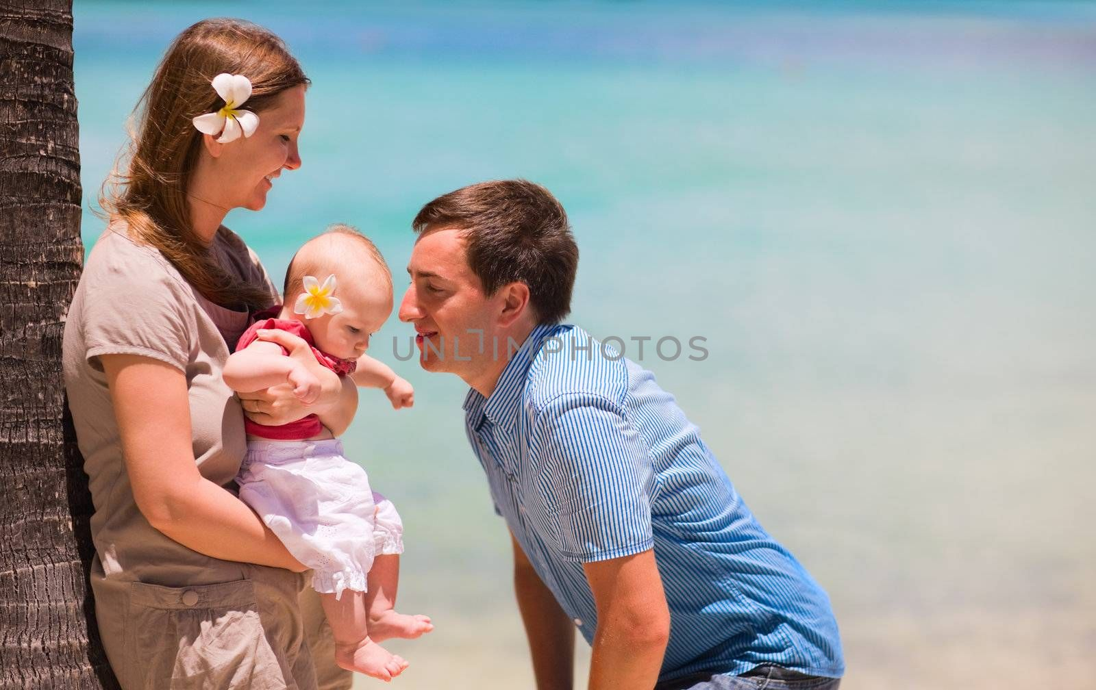 Family vacation. Young family of three on vacation