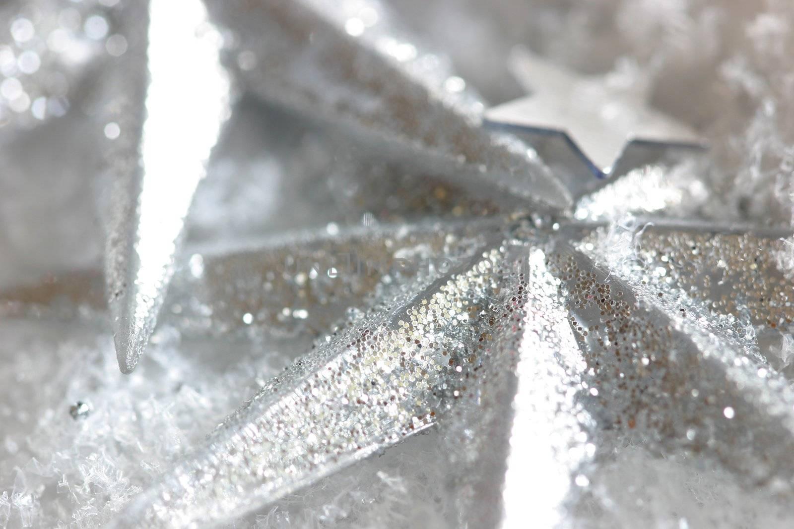 Shiny christmas stars on snow