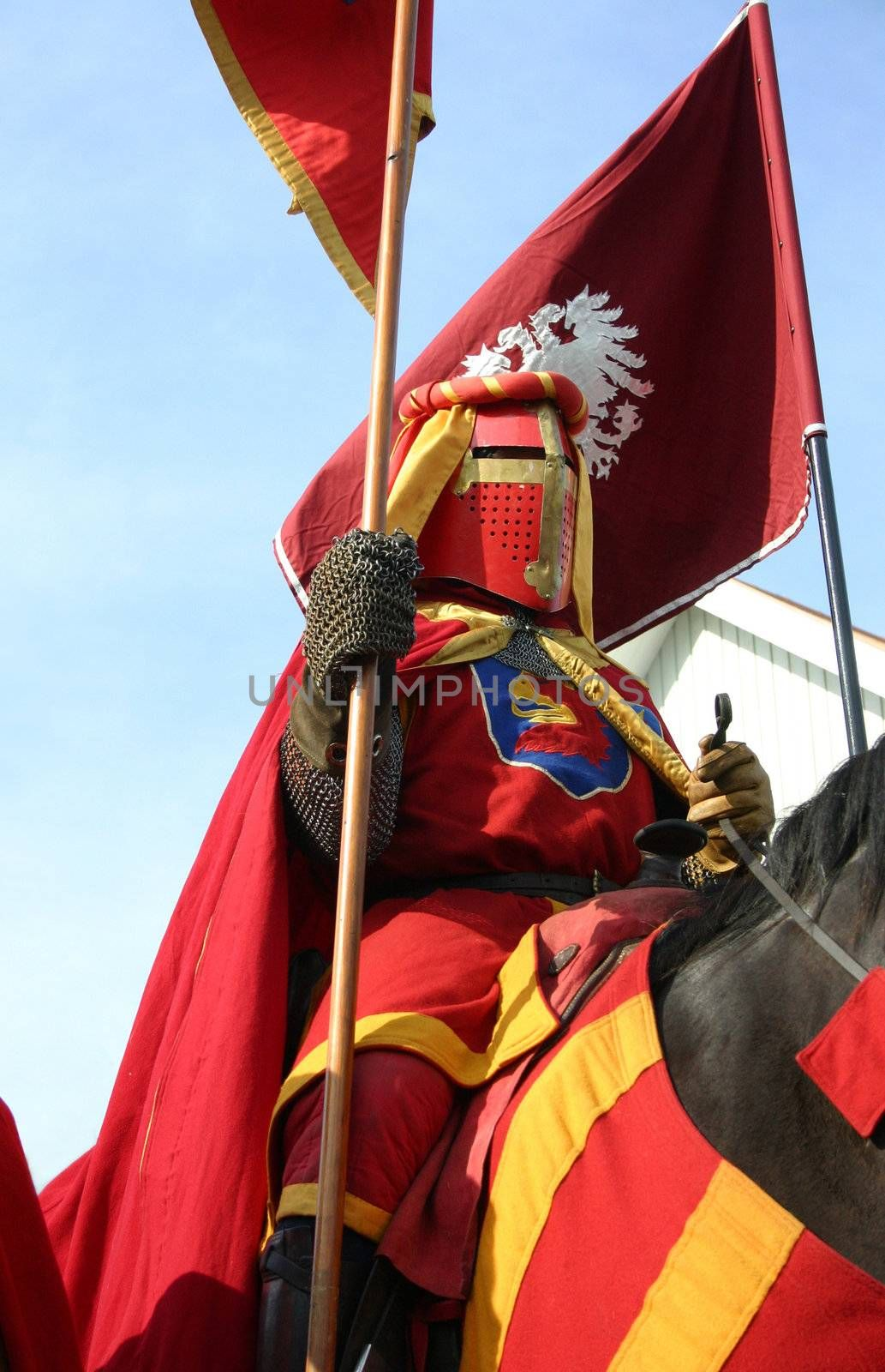A knight riding by during Hova Riddarvecka, a weak of medieval festivities in the small town of Hova, Sweden