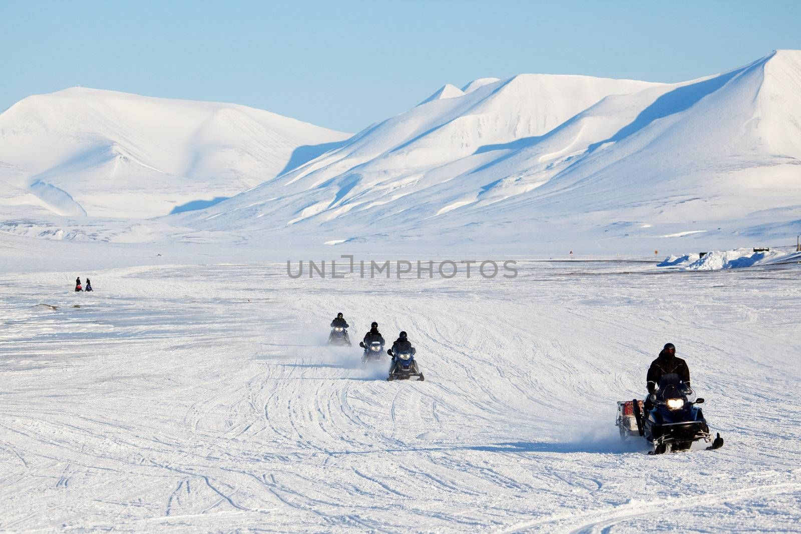 A group of snowmobiles on the ice outside Longyearbyen, Svalbard Norway