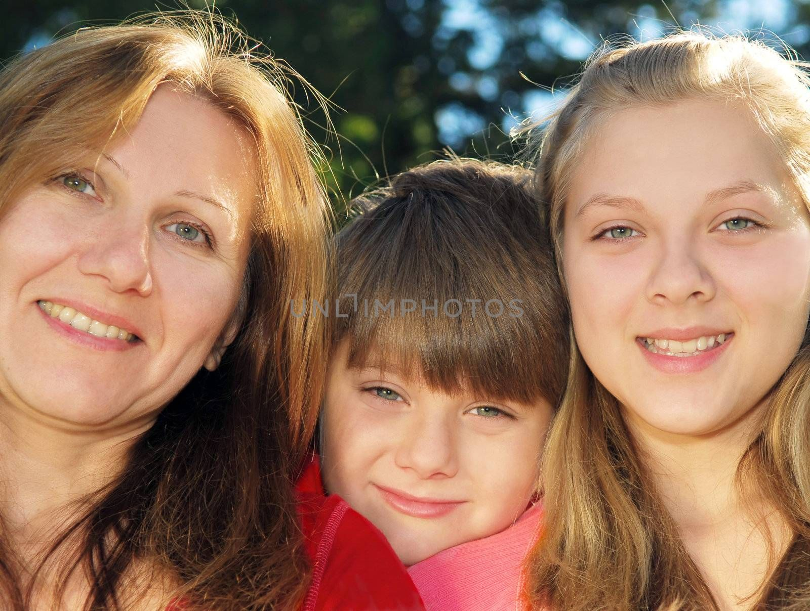 Portrait of a smiling family of mother and her children