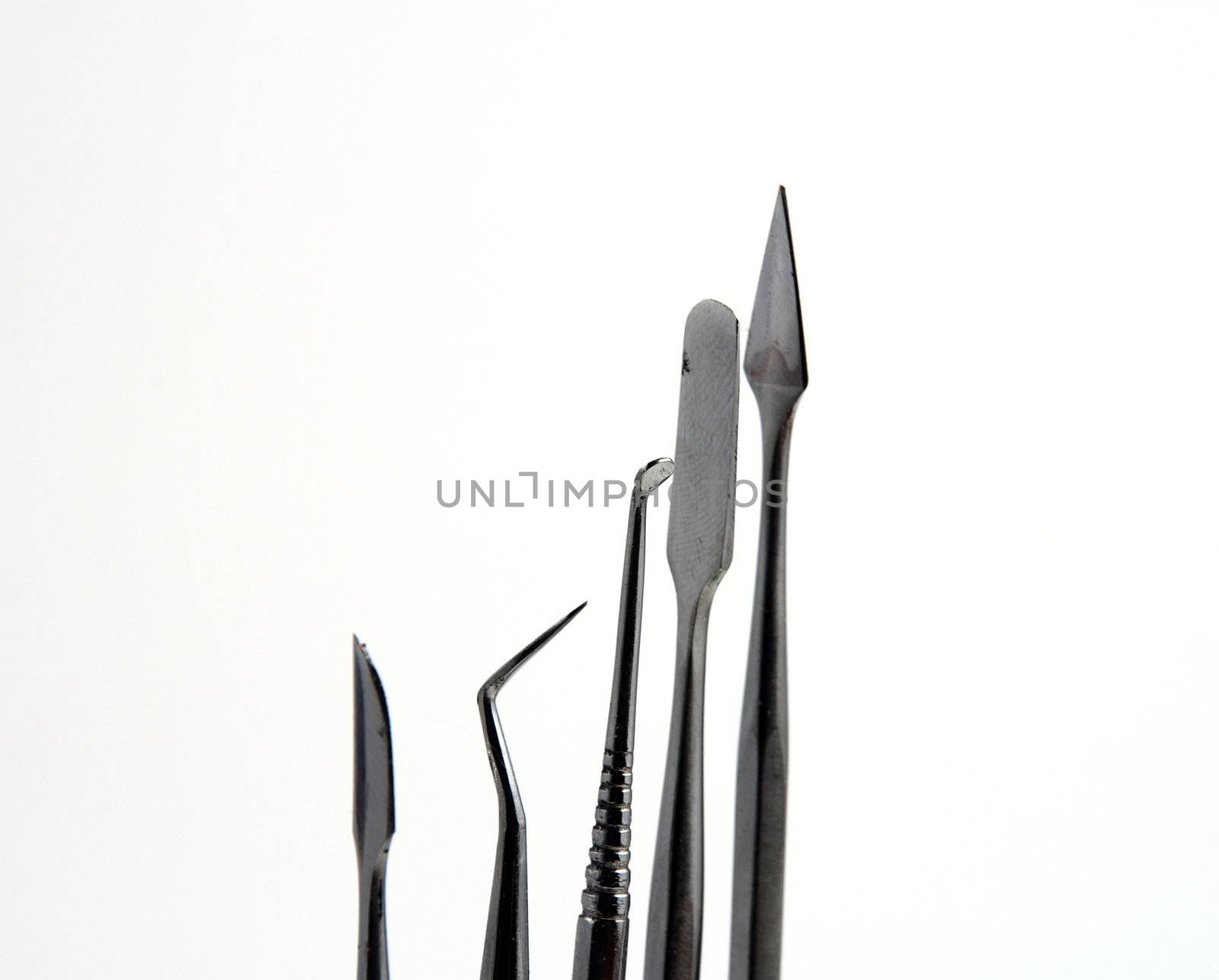 Stock pictures of metal dental instruments used to work on patients