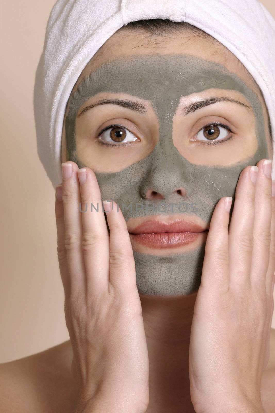 Beautiful girl wearing a purifying beauty mask on her face.