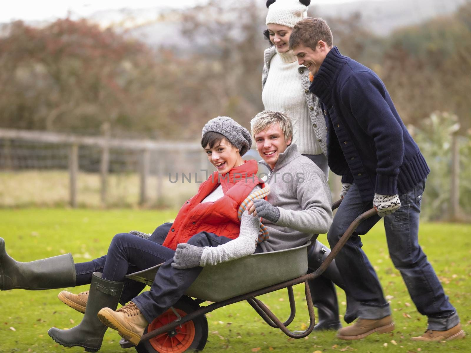 Two young couples playing in wheelbarrow