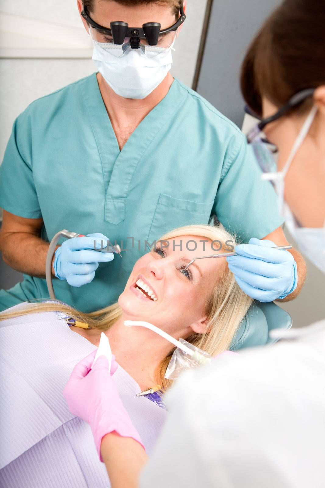 A woman at the dentist about to have some drilling done