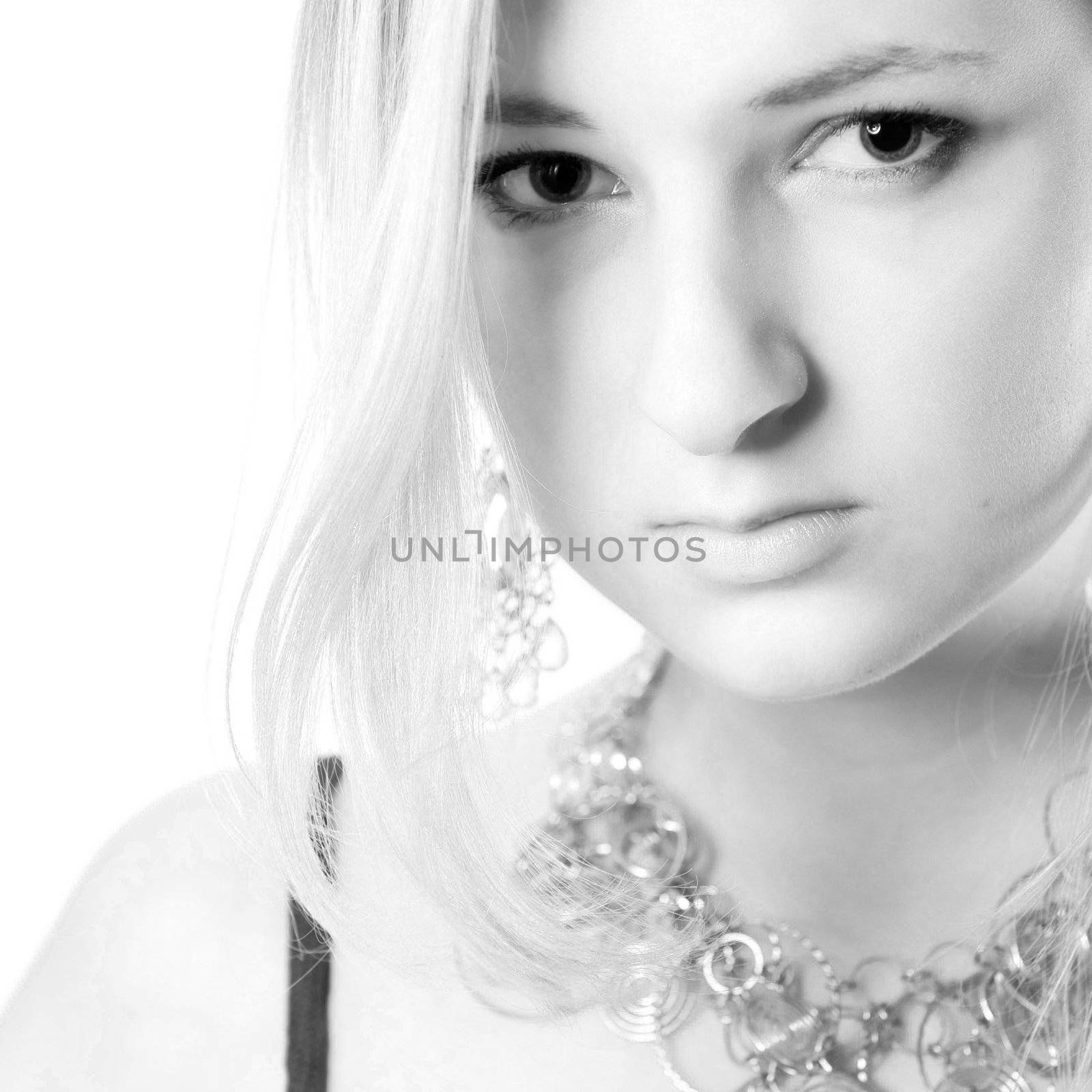 Young girl in a dress in the studio on a white background.