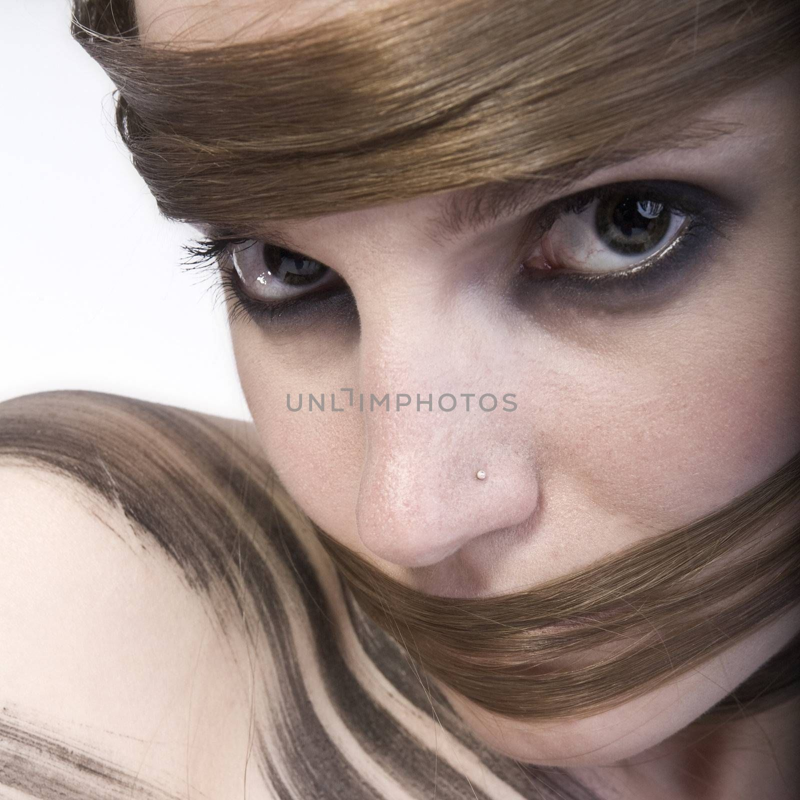 Studioportrait of a long haired girl