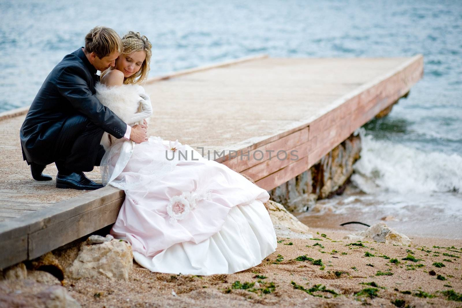 Romantic wedding couple at beach