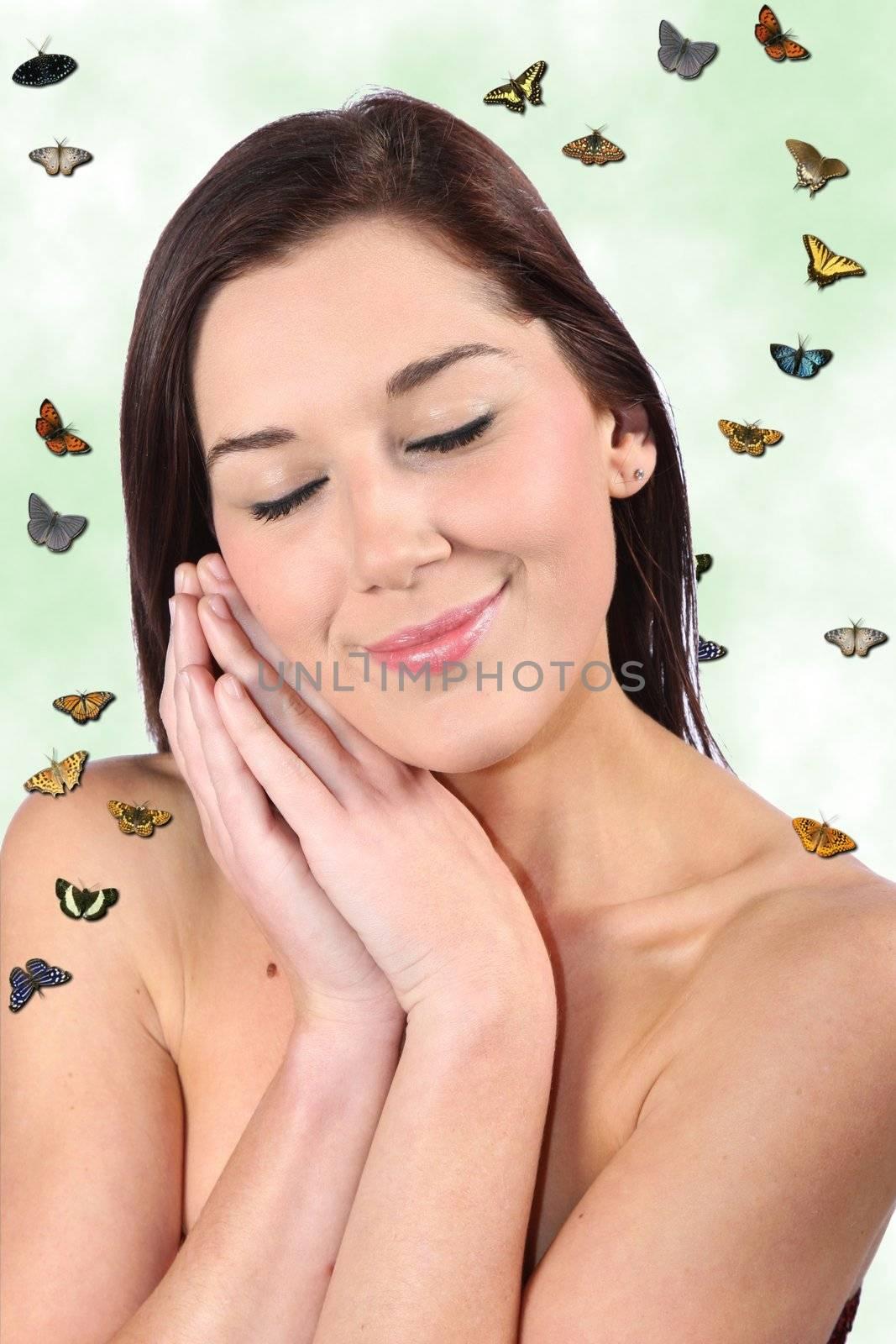 Beautiful brunette woman dreaming of spring season