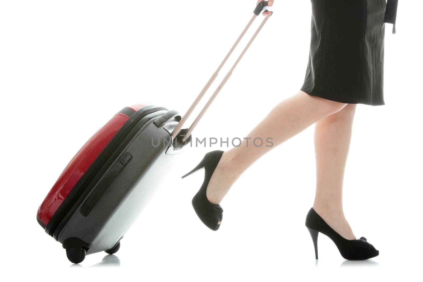 Businesswoman legs with a suitcase on the white background