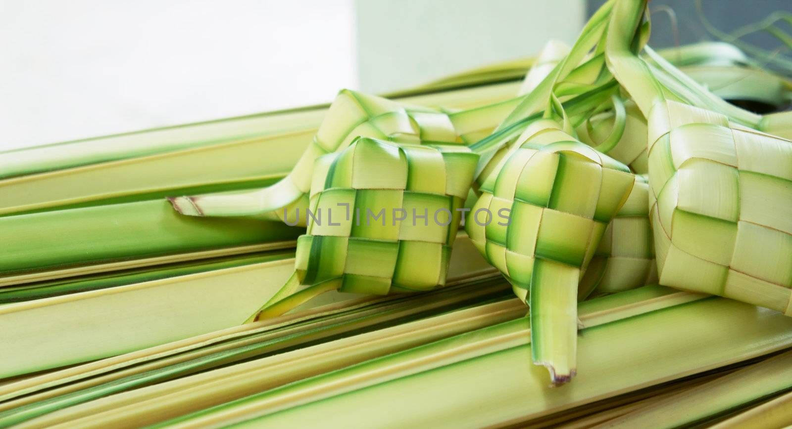 Ketupat: South East Asian rice cakes bundle, often prepared for festivities and celebratory occasions.