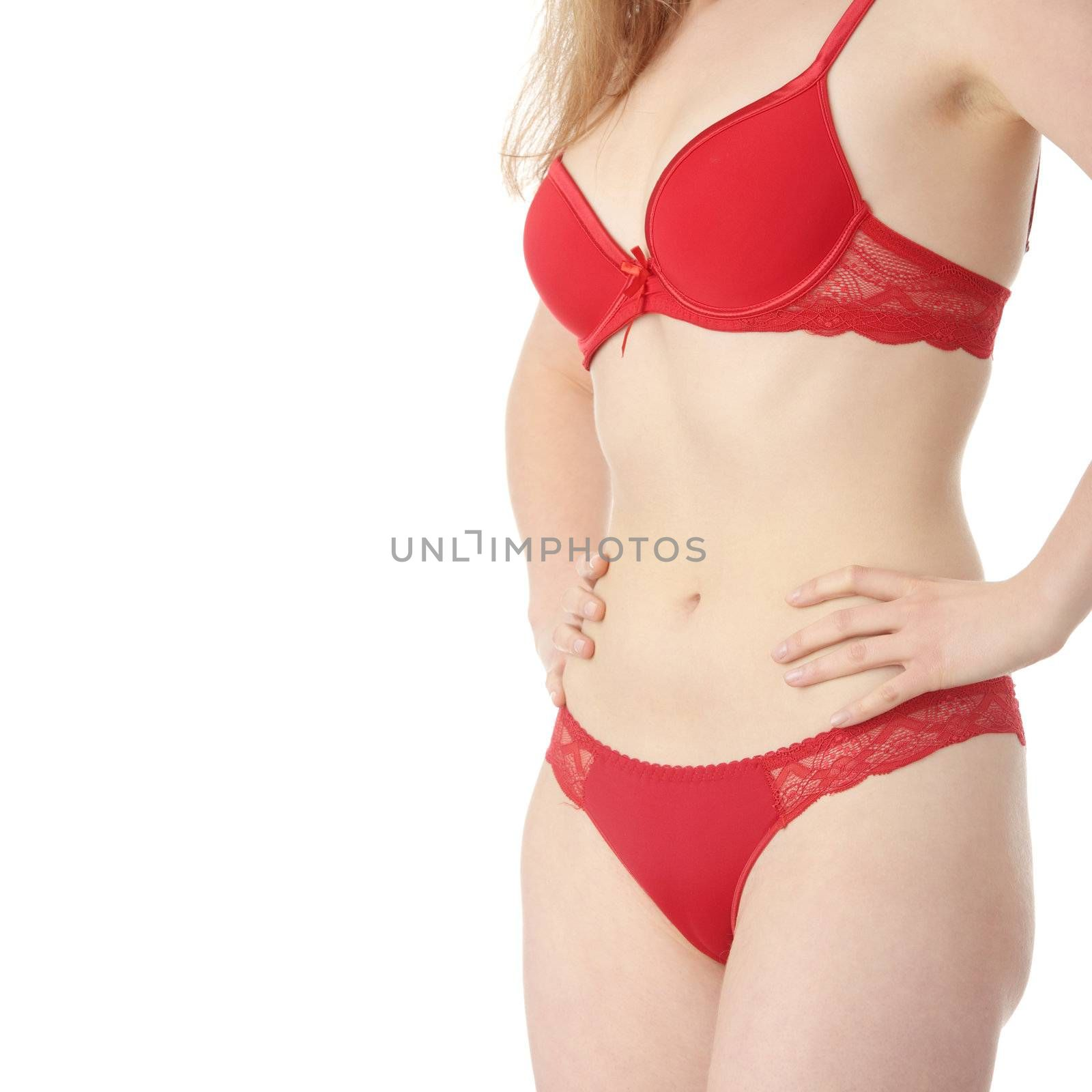 Beautiful caucasian woman in red lingerie with hand on her belly isolated on white background
